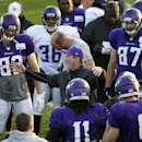 Minnesota Vikings head coach Mike Zimmer, center, talks to his team during an NFL football training camp practice, Monday, July 28, 2014, in Mankato, Minn The Associated Press