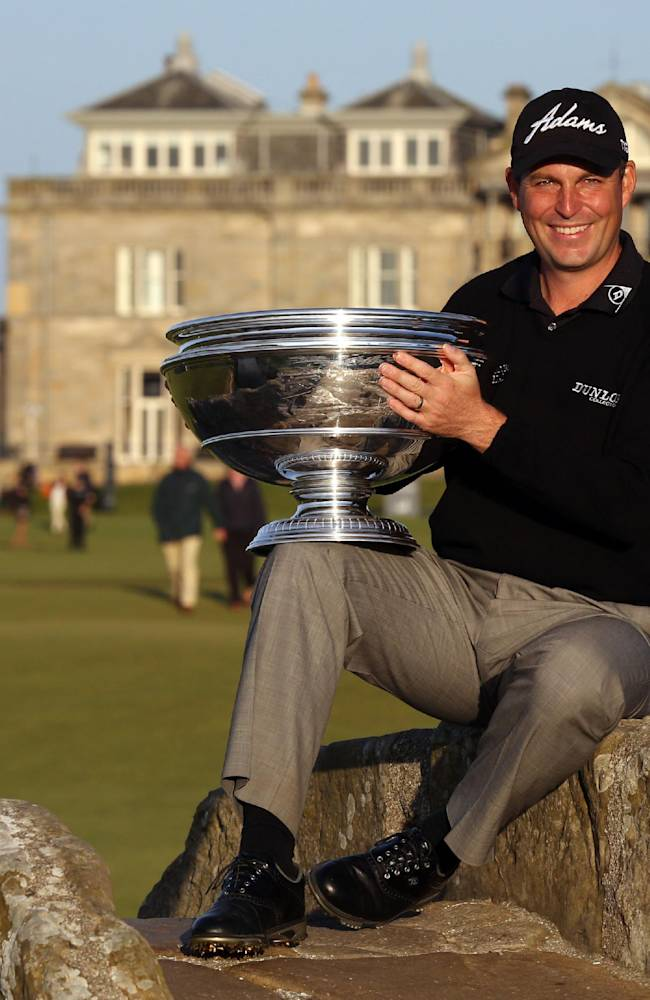 David Howell holds the trophy as he celebrates winning the 2013 Alfred Dunhill Links Championships at St Andrews Golf Course, in St Andrews, Scotland, Sunday Sept. 29, 2013.  England's David Howell ended a seven-year winless drought with a playoff victory over American Peter Uihlein to capture the Alfred Dunhill Links Championship on Sunday. (AP Photo / David Cheskin, PA)