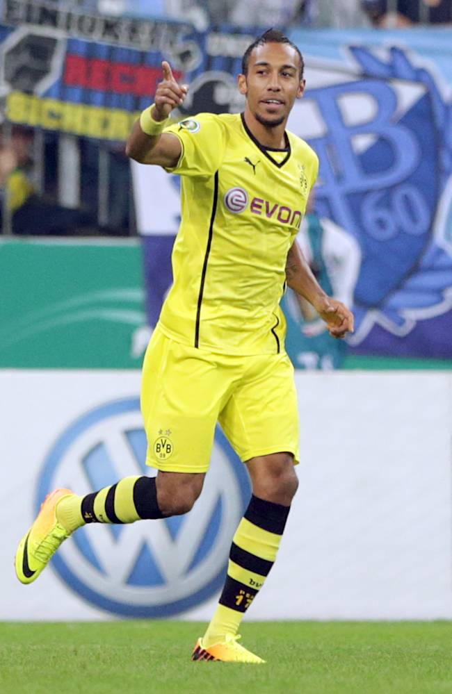 Dortmund's Pierre-Emerick Aubameyang of Gabon celebrates after scoring his side's opening goal during the German soccer cup second round match between TSV 1860 Munich and Borussia Dortmund, in Munich, southern Germany, Tuesday, Sept. 24, 2013