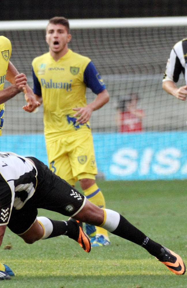 Udinese Colombian forward Luis Muriel, bottom, is fouled by Chievo's Ivan Radovanovic, of Serbia, during a Serie A soccer match at the Bentegodi stadium in Verona, Italy, Saturday, Sept. 21, 2013
