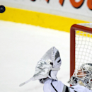 Los Angeles Kings goalie Ben Scrivens gloves the puck during the second period of an NHL hockey game against the Vancouver Canucks, in Vancouver, British Columbia, Monday, Nov. 25, 2013 The Associated Press