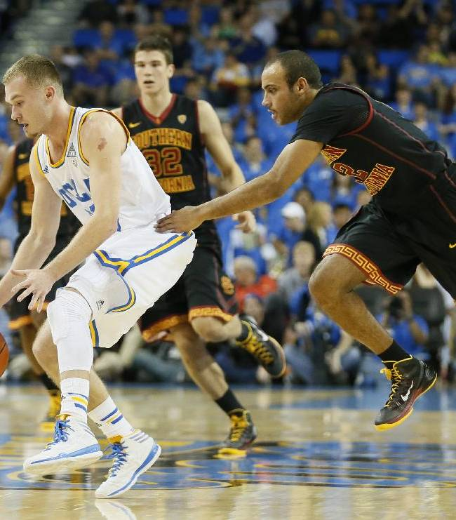 UCLA's Bryce Alford, left, steals the ball from Southern California's Julian Jocobs, right, during the first half of an NCAA college basketball game on Sunday, Jan. 5, 2014, in Los Angeles