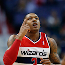 WASHINGTON, DC - APRIL 02: Bradley Beal #3 of the Washington Wizards celebrates after scoring against the Chicago Bulls during the first half at Verizon Center on April 2, 2013 in Washington, DC. (Photo by Rob Carr/Getty Images)