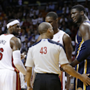 Referee Dan Crawford (43) talks with Indiana Pacers' Roy Hibbert (55) as Miami Heat's LeBron James (6) listens during the first half of an NBA basketball game, Friday, April 11, 2014, in Miami The Associated Press
