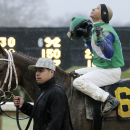 FILE - In this Feb. 22, 2015, file photo, jockey Mike Smith looks skyward after winning the $300,000 Southwest Stakes horse race aboard Far Right at Oaklawn Park in Hot Springs, Ark. Far Right moves into the top 10 in the Race to the roses after winning the Southwest Stakes. (AP Photo/Danny Johnston, File)