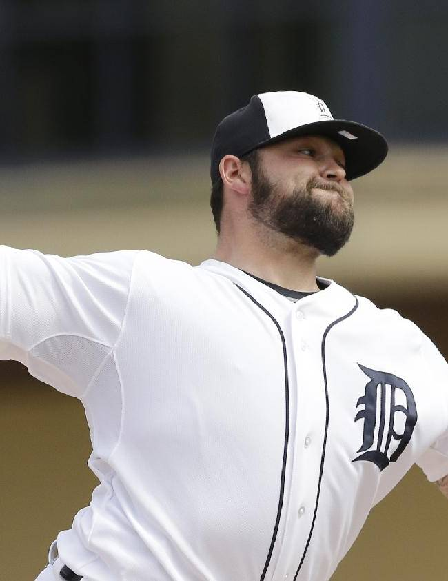 Detroit Tigers relief pitcher Joba Chamberlain throws during the seventh inning of a spring exhibition baseball game against the Toronto Blue Jays in Lakeland, Fla., Tuesday, March 11, 2014