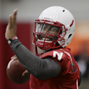 Nebraska quarterback Tommy Armstrong Jr. smiles while throwing on the first day of spring NCAA college football practice in Lincoln, Neb., Saturday, March 8, 2014. (AP Photo/Nati Harnik)