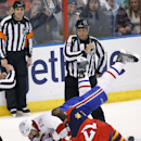Montreal Canadiens right wing George Parros (15) and Florida Panthers right wing Krys Barch (21) fight as officials watch during the first period of an NHL hockey game in Sunrise, Fla., on Saturday, March 29, 2014. Montreal won 4-1 The Associated Press