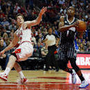 Orlando Magic guard Doron Lamb, right, gets past Chicago Bulls guard Jimmer Fredette, left, during the first half of an NBA basketball game Monday, April 14, 2014, in Chicago The Associated Press