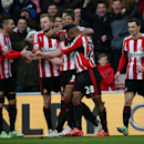 Sunderland's Jermain Defoe, second right, celebrates his goal with his teammates during their English Premier League soccer match between Sunderland and Burnley at the Stadium of Light, Sunderland, England, Saturday, Jan. 31, 2015