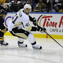 Buffalo Sabres left winger Johan Larsson (22) chases Pittsburgh Penguins defenseman Robert Bortuzzo (41) during the first period of an NHL hockey game Saturday, Nov. 8, 2014, in Buffalo, N.Y The Associated Press