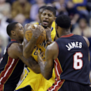 Indiana Pacers forward Paul George, center, is trapped by Miami Heat forward LeBron James, right, and guard Mario Chalmers in the first half of an NBA basketball game in Indianapolis, Tuesday, Dec. 10, 2013 The Associated Press