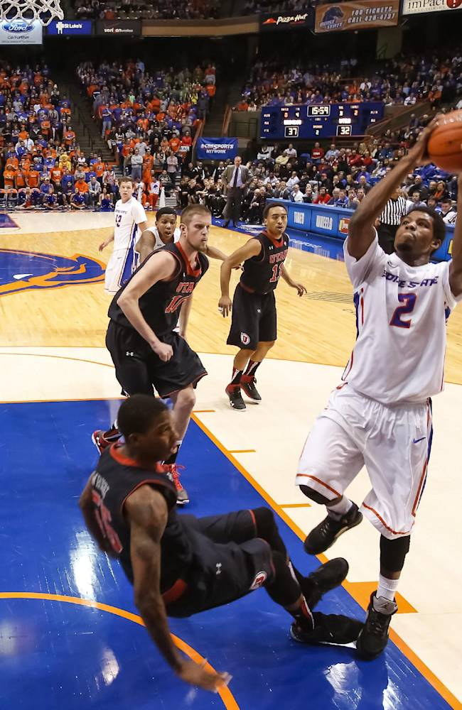 Boise State's Derrick Marks (2) shoots over Utah's Delon Wright during the second half of an NCAA college basketball game in Boise, Idaho, on Tuesday, Dec. 3, 2013. Boise State beat Utah 69-67