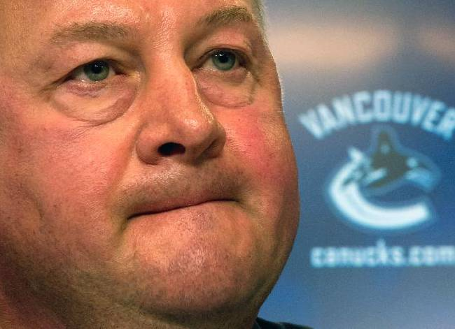 In this May 22, 2013 file photo, Vancouver Canucks president and general manager Mike Gillis addresses reporters in Vancouver, British Columbia. The Canucks have fired Gillis, Tuesday, April 8, 2014,  a day after being eliminated from playoff contention