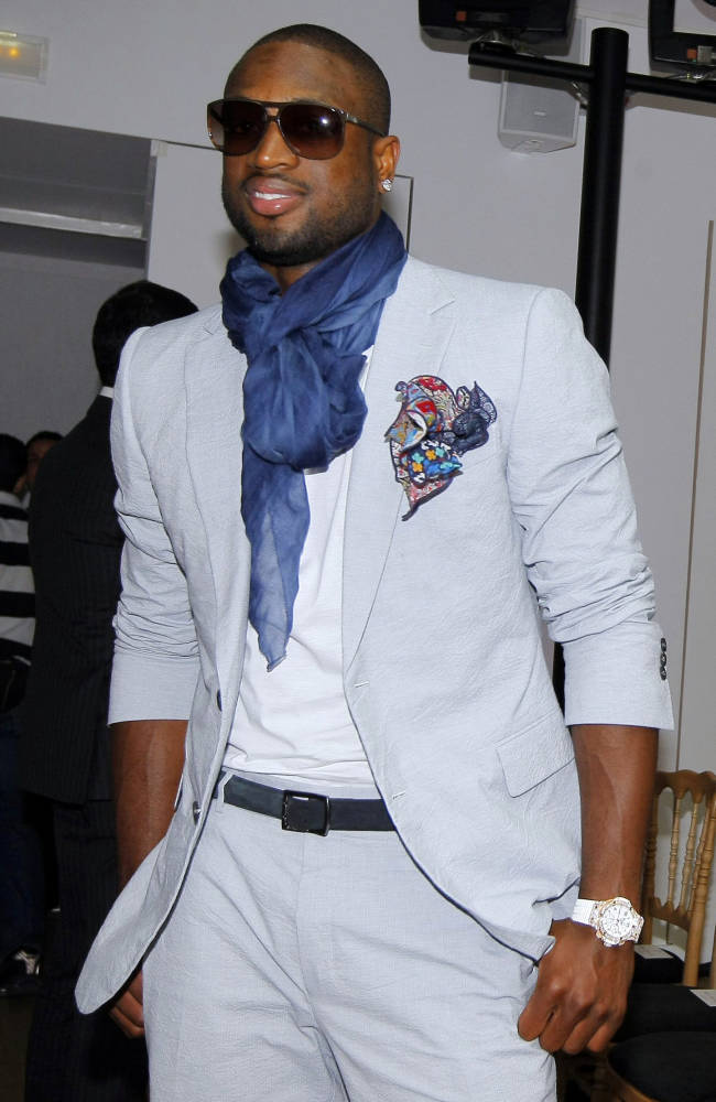 FILE - In this June 24, 2011 file photo, Miami Heat basketball player Dwyane Wade attends a fashion show of the Yves Saint Laurent collection as part of spring-summer 2012 men's fashion season presented in Paris. The Miami Heat star says while he always was a fan of fine dressing, it wasn't until the former commissioner of the league instituted a dress code that he started taking more interest in what he would wear off the court. Now Wade is considered among the more fashion-forward stars in a league where players dress to impress.  (AP Photo/Jacques Brinon, File)