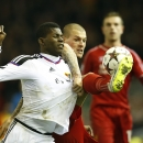 Basel's Breel Embolo, left, is challenged by Liverpool's Martin Skrtel during the Champions League Group B soccer match between Liverpool and FC Basel at Anfield Stadium in Liverpool, England, Tuesday, Dec. 9, 2014