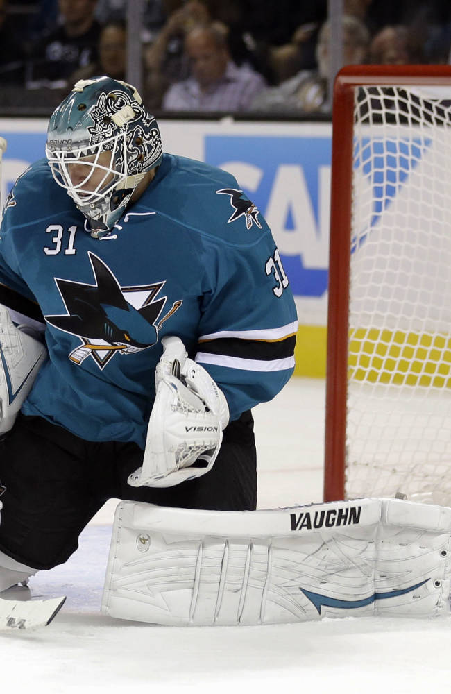 San Jose Sharks goalie Antti Niemi, of Finland, stops a shot by the Vancouver Canucks during the second period of an NHL hockey game Thursday, Oct. 3, 2013, in San Jose, Calif