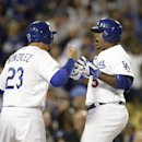 Los Angeles Dodgers' Juan Uribe, right, celebrates his two-run home run with Adrian Gonzalez during the fourth inning of a baseball game against the Philadelphia Phillies on Thursday, April 24, 2014, in Los Angeles The Associated Press