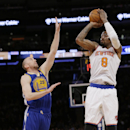 New York Knicks' J.R. Smith (8) shoots over Golden State Warriors' Steve Blake (25) during the first half of an NBA basketball game on Friday, Feb. 28, 2014, in New York The Associated Press
