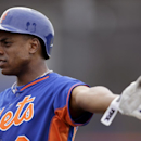 New York Mets' Curtis Granderson talks to a teammate while waiting to take batting practice during spring training baseball Saturday, Feb. 22, 2014, in Port St. Lucie, Fla The Associated Press