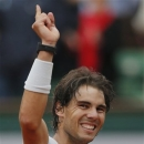 Spain's Rafael Nadal celebrates winning against compatriot David Ferrer in three sets 6-3, 6-2, 6-3, in the final of the French Open tennis tournament, at Roland Garros stadium in Paris, Sunday June 9, 2013. (AP Photo/Michel Spingler)