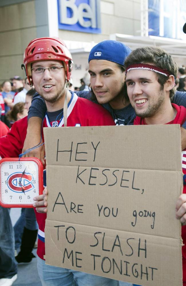 Montreal Canadien fans hold a message for Toronto Maple Leafs player Phil Kessel during the pre-game festivities before the a season opener NHL hockey game between the Maple Leafs and the Montreal Canadiens on Tuesday, October 1, 2013, in Montreal