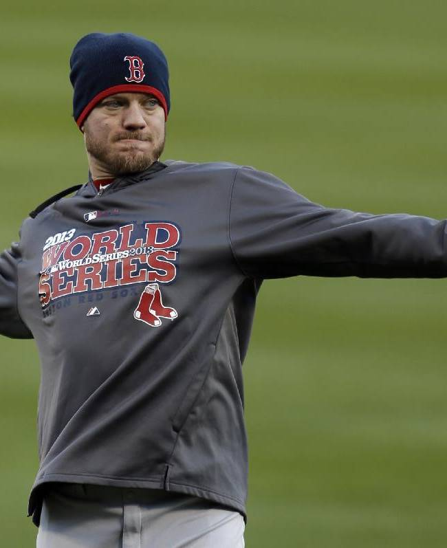 Boston Red Sox pitcher Jake Peavy throws during baseball practice on Friday, Oct. 25, 2013, in St. Louis. Peavy is slated to start when the Red Sox play the St. Louis Cardinals in Game 3 of the World Series scheduled for Saturday in St. Louis