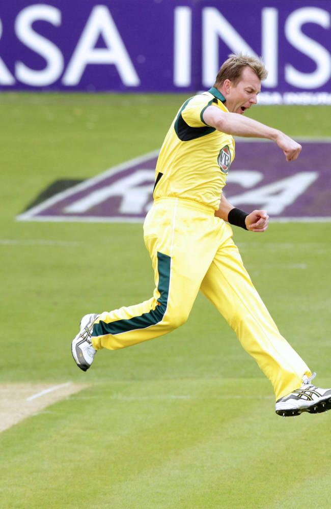 Australia's cricketer Brett Lee leaps in
