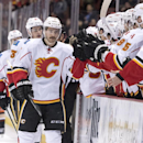 Calgary Flames' TJ Brodie, left, celebrates his goal with the bench against the Anaheim Ducks during an NHL hockey game Tuesday, Nov. 25, 2014, in Anaheim, Calif The Associated Press
