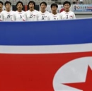 North Korea's national soccer team players sing their national anthem before the Women's East Asian Cup soccer championship match against South Korea at the Seoul World Cup stadium in Seoul July 21, 2013. REUTERS/Lee Jae-Won