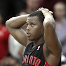 Toronto Raptors' Kyle Lowry watches the final seconds of the game against the Houston Rockets from the bench after fouling out in overtime of an NBA basketball game Monday, Nov. 11, 2013, in Houston. The Rockets won 110-104 in double overtime The Associat