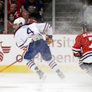 Edmonton Oilers left wing Taylor Hall (4) skates past Chicago Blackhawks defenseman Brent Seabrook (7) during the first period of the NHL hockey game on Sunday, Nov. 10, 2013, in Chicago The Associated Press