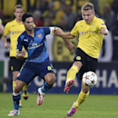 Dortmund's Ciro Immobile, right, is challenged by Arsenal's Mikel Arteta, left, during the Champions League group D soccer match between Borussia Dortmund and Arsenal in Dortmund, Germany, Tuesday, Sept.16, 2014