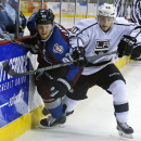 Los Angeles Kings center Jordan Weal (60) gets past Colorado Avalanche left wing Gabriel Landeskog (92) during a preseason NHL hockey game Thursday, Oct. 2, 2014, in Colorado Springs, Colo. The Kings defeated the Avalanche 2-1 in a shootout The Associate