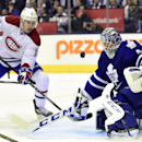 Montreal Canadiens' Rene Bourque looks on as Toronto Maple Leafs goalie Jonathan Bernier makes a save during first period NHL hockey action in Toronto on Wednesday, Oct. 8, 2014 The Associated Press