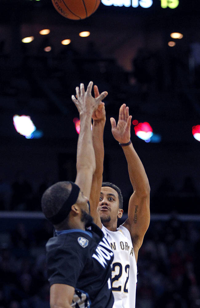 New Orleans Pelicans point guard Brian Roberts (22) shoots a three-point shot over Minnesota Timberwolves small forward Corey Brewer with 22 seconds left in the second half of an NBA basketball game in New Orleans, Friday, Feb. 7, 2014. The Pelicans won 98-91