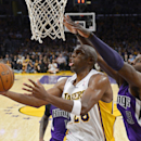 Los Angeles Lakers guard Jodie Meeks, left, puts up a shot as Sacramento Kings forward Patrick Patterson defends during the second half of an NBA basketball game, Sunday, Nov. 24, 2013, in Los Angeles The Associated Press