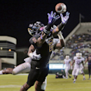 In this Oct. 23, 2014, file photo, East Carolina's Justin Hardy (2) catches a touchdown pass ahead of Connecticut's Jhavon Williams during an NCAA college football game in Greenville, N.C. East Carolina senior wide receiver Justin Hardy has won the Burlsw