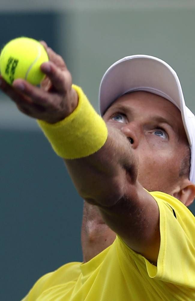 Nikolay Davydenko, of Russia, serves to Adrian Mannarino, of France, during the first round at the Sony Open tennis tournament at Key Biscayne, Fla., Wednesday, March 19, 2014
