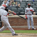 Cincinnati Reds' Joey Votto hits a two-run homer during the third inning of the baseball game against the New York Mets at Citi Field Wednesday, May 22, 2013 in New York. (AP Photo/Seth Wenig)