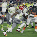 Kansas City Chiefs' Jamaal Charles runs past the Team Irvin defense during the first half of the NFL Football Pro Bowl Sunday, Jan. 25, 2015, in Glendale, Ariz The Associated Press