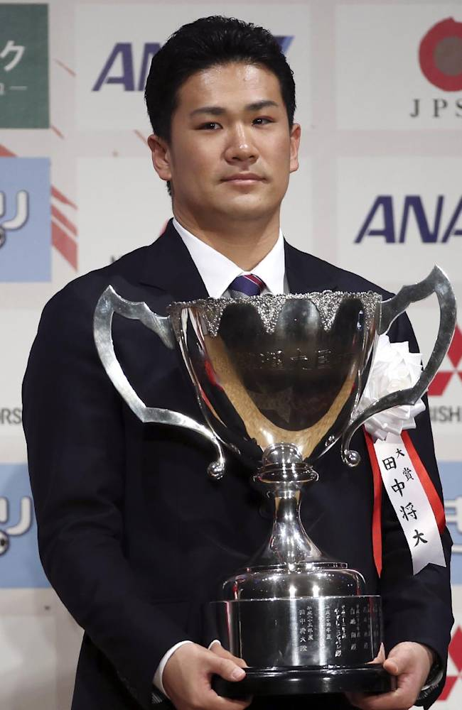 Star pitcher Masahiro Tanaka of Japanese baseball club Rakuten Golden Eagles poses with his grand prix trophy during an awarding ceremony of the Japan Professional Sports Award in Tokyo, Friday, Dec. 27, 2013. All 30 major league teams have been notified that the 30-day period to sign the 25-year-old right-hander began at 1300 GMT Thursday, according to Major League Baseball spokesman Michael Teevan. Clubs have until 2200 GMT on Jan. 24 to attempt to reach an agreement with the ace