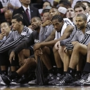 Members of the San Antonio Spurs sit on the bench during the second half of Game 2 of the NBA Finals basketball game against the Miami Heat, Sunday, June 9, 2013 in Miami. The Miami Heat won 103-84. (AP Photo/Lynne Sladky)