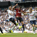 Queens Park Rangers' Loic Remy, center, competes for the ball with Tottenham Hotspur's Eric Dier, right, and Younes Kaboul during their English Premier League soccer match at White Hart Lane, London, Sunday, Aug. 24, 2014. (AP Photo / Sang Tan)