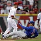 Chicago Cubs' Anthony Rizzo (44) slides safely into second base with a double as Cincinnati Reds shortstop Zack Cozart (2) catches the throw in the eighth inning of a baseball game, Saturday, May 25, 2013, in Cincinnati. Cincinnati won 5-2. (AP Photo/Al Behrman)