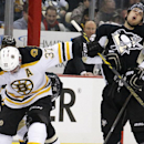 Pittsburgh Penguins' Brandon Sutter recoils after getting a stick in the face during a face-off with Boston Bruins' Patrice Bergeron (37) during the second period of an NHL hockey game in Pittsburgh Wednesday, Jan. 7, 2015 The Associated Press