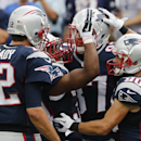 In this Sept. 21, 2014, file photo, New England Patriots tight end Rob Gronkowski, rear, celebrates his touchdown catch from Tom Brady, left, with running back Shane Vereen, second from left, and wide receiver Danny Amendola, right, during the first half