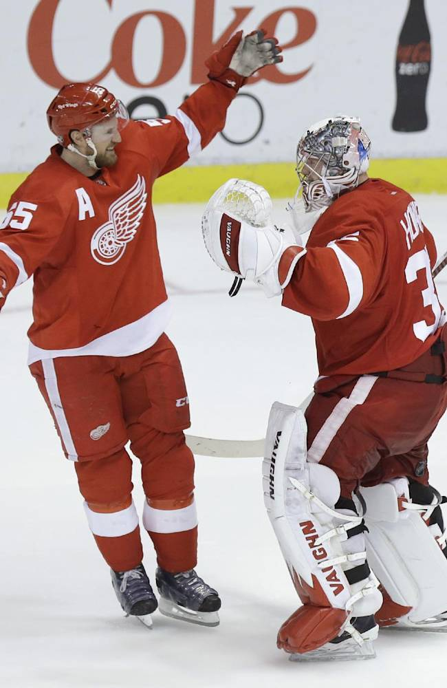 Detroit Red Wings goalie Jimmy Howard (35) is congratulated by teammate Niklas Kronwall (55), of Sweden, after their 3-2 win over the Los Angeles Kings during the shootout period of an NHL hockey game in Detroit, Saturday, Jan. 18, 2014