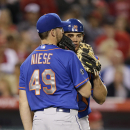New York Mets starting pitcher Jonathon Niese (49) talks with catcher Anthony Recker during the sixth inning of a baseball game against the Los Angeles Angels on Saturday, April 12, 2014, in Anaheim, Calif The Associated Press