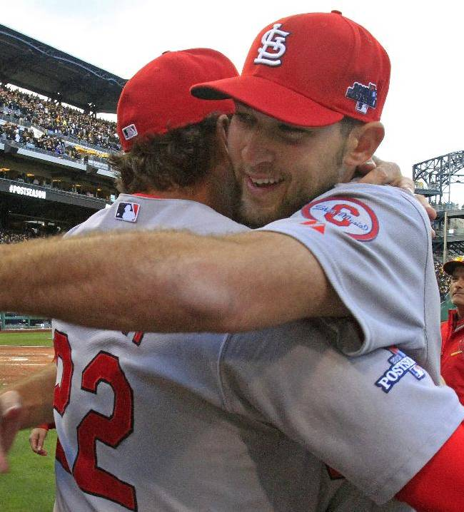 St. Louis Cardinals pitcher Michael Wacha, right, gets a hug from manager Mike Matheny after a 2-1 win over the Pittsburgh Pirates in Game 4 of a National League division baseball series on Monday, Oct. 7, 2013 in Pittsburgh